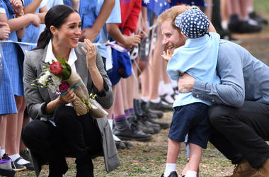 Prince Harry Duke of Sussex and Meghan Duchess of Sussex arrive at Dubbo Airport where they meet Luke Vincent, 5, from Buninyong Public School Kindergarten, New South Wales, Australia.