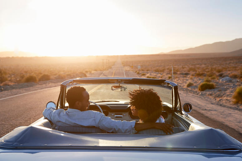 Rear View Of Couple On Road Trip