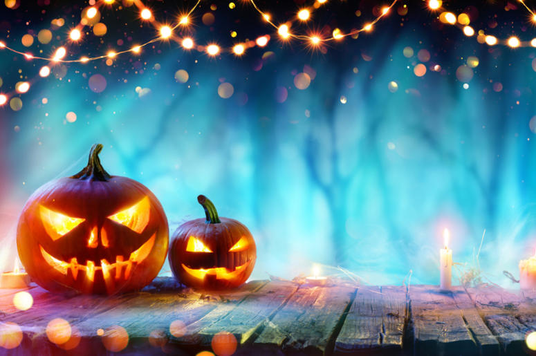 Halloween Party - Jack O' Lanterns And String Lights On Table In Misty Forest