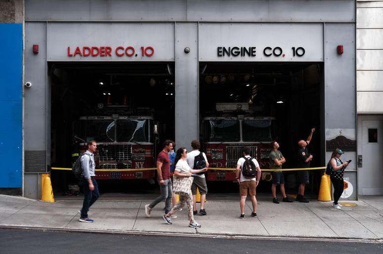 People walk by Engine and Ladder Company 10 across from the grounds of the September 11 Memorial and Museum on September 05, 2019 in New York City. New York City is preparing to commemorate the 18th anniversary of the attacks on the World Trade Center in