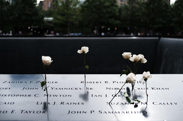 Roses are placed in the names of victims on the grounds of the September 11 Memorial and Museum on September 05, 2019 in New York City. New York City is preparing to commemorate the 18th anniversary of the attacks on the World Trade Center in which 2,996