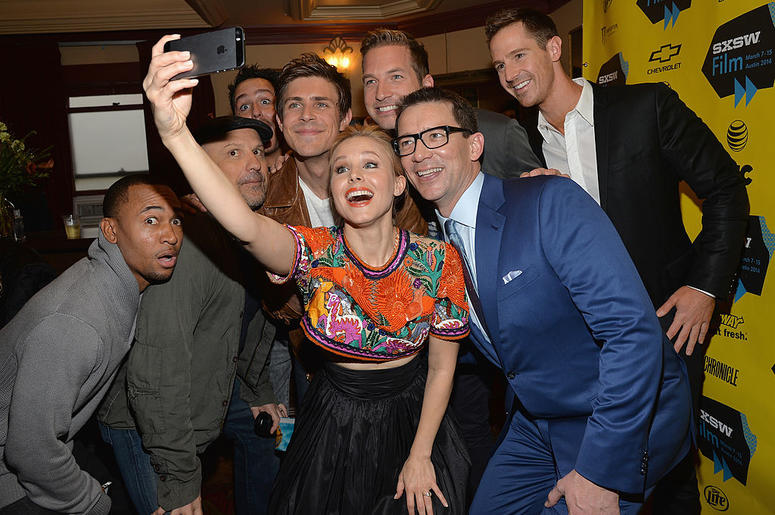 """Actress Kristen Bell (C) poses for a selfie with cast members (L-R) Percy Daggs, Enrico Colantoni, Chris Lowell, Ryan Hansen, Jason Dohring and director Rob Thomas at the premiere of """"Veronica Mars"""" during the 2014 SXSW Music, Film + Interactive Festival"""