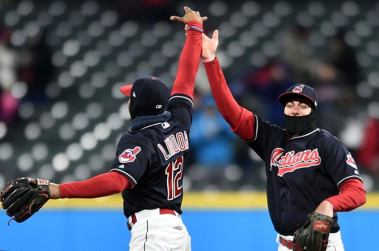 Cleveland Indians shortstop Francisco Lindor (12) and center fielder Bradley Zimmer (4)