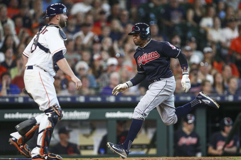 Cleveland Indians center fielder Rajai Davis (26) scores a run as Houston Astros catcher Brian McCann (16) looks on during the fifth inning at Minute Maid Park.