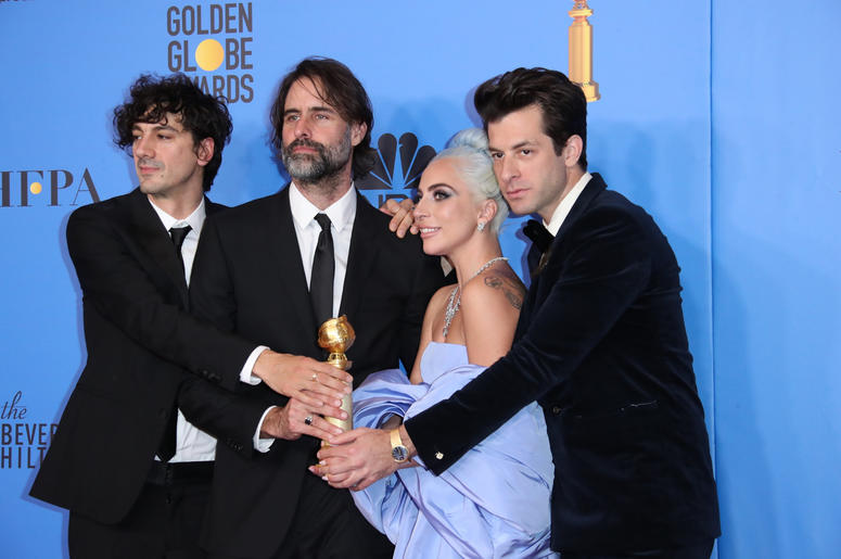 """Anthony Rossomando, from left, Andrew Wyatt, Lady Gaga and Mark Ronson pose in the press room with the award for best original song, motion picture for \""""Shallow\"""" from the film \""""A Star Is Born\"""" at the 76th"""