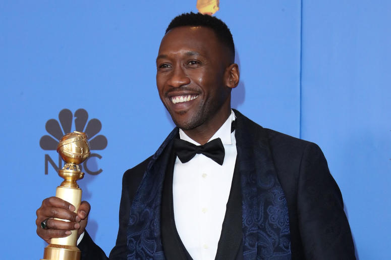 """Mahershala Ali poses in the press room with the award for best performance by an actor in a supporting role in any motion picture for \""""Green Book\"""" at the 76th Golden Globe Awards at the Beverly Hilton."""