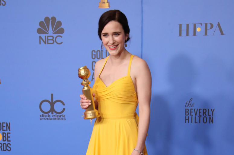 """Rachel Brosnahan poses in the press room with the award for best performance by an actress in a television series, musical or comedy for \""""The Marvelous Mrs. Maisel\"""" at the 76th Golden Globe Awards"""