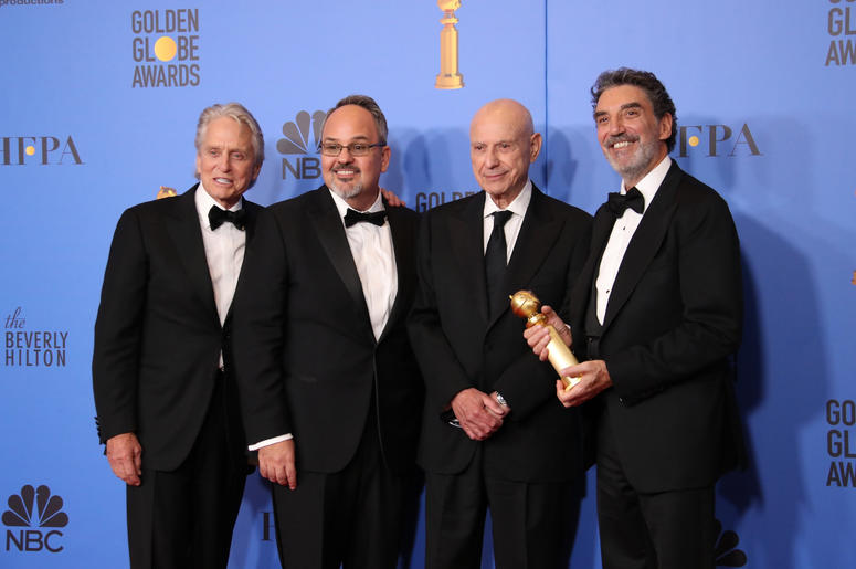 From left, Michael Douglas, Al Higgins, Alan Arkin and Chuck Lorre pose with their award for Best Television Series - Musical or Comedy for 'The Kominsky Method' in the photo room at the 76th Golden Globe Awards at the Beverly Hilton.