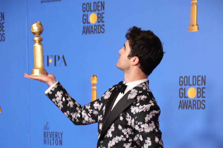 """Darren Criss poses in the press room with the award for best performance by an actor in a limited series or a motion picture made for television for \""""The Assassination of Gianni Versace: American Crime Story\"""" at the 76th Golden Globe Awards at the Bever"""