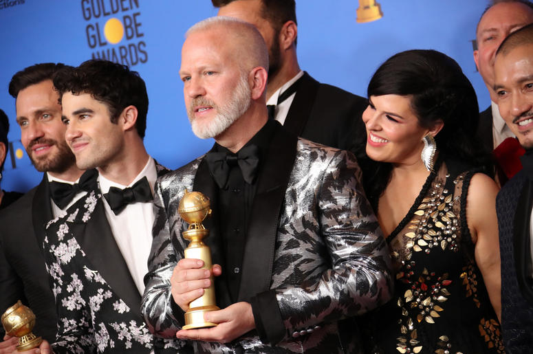 """he cast and crew of \""""The Assassination of Gianni Versace: American Crime Story\"""" pose in the press room with the award for best television limited series or motion picture made for television at the 76th Golden Globe Awards at the Beverly Hilton."""
