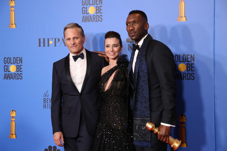 """Viggo Mortensen, from left, Linda Cardellini and Mahershala Ali pose in the press room with the award for best motion picture, musical or comedy for \""""Green Book\"""" at the 76th annual Golden Globe Awards atthe 76th Golden Globe Awards at the Beverly Hilton"""