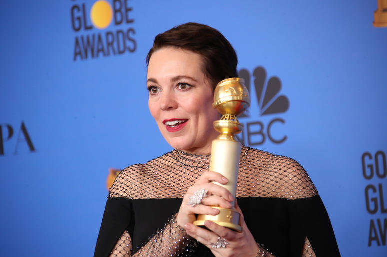 """Olivia Colman poses in the press room with the award for best performance by an actress in a motion picture, musical or comedy for \""""The Favourite\"""" at the 76th Golden Globe Awards at the Beverly Hilton."""