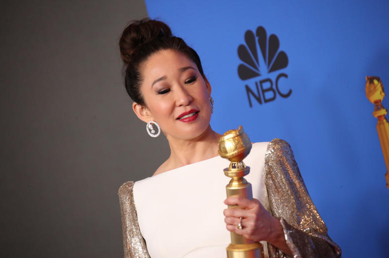 """Sandra Oh poses in the press room with the award for best performance by an actress in a television series, drama for \""""Killing Eve\"""" at the 76th Golden Globe Awards at the Beverly Hilton."""