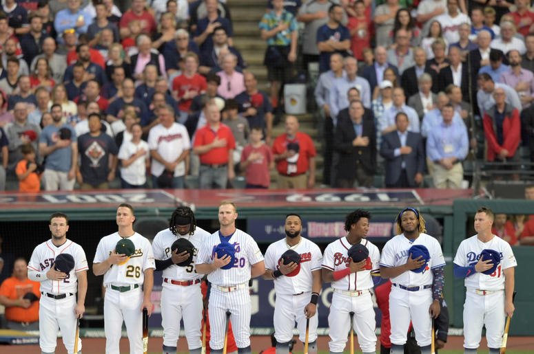 The participants stand for the National Anthem prior to the 2019 MLB Home Run Derby at Progressive Field.