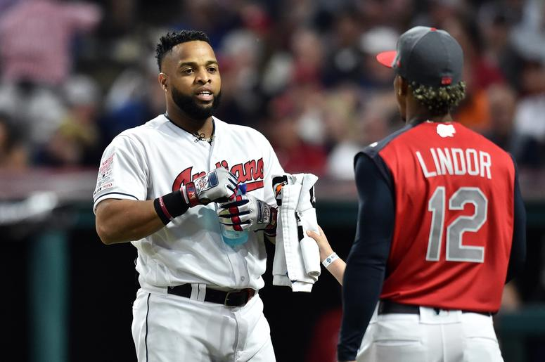 Cleveland Indians first baseman Carlos Santana (41) talks with teammate Francisco Lindor during the first round in the 2019 MLB Home Run Derby at Progressive Field.