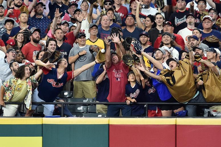Fans reach for a home run during the second round in the 2019 MLB Home Run Derby at Progressive Field.