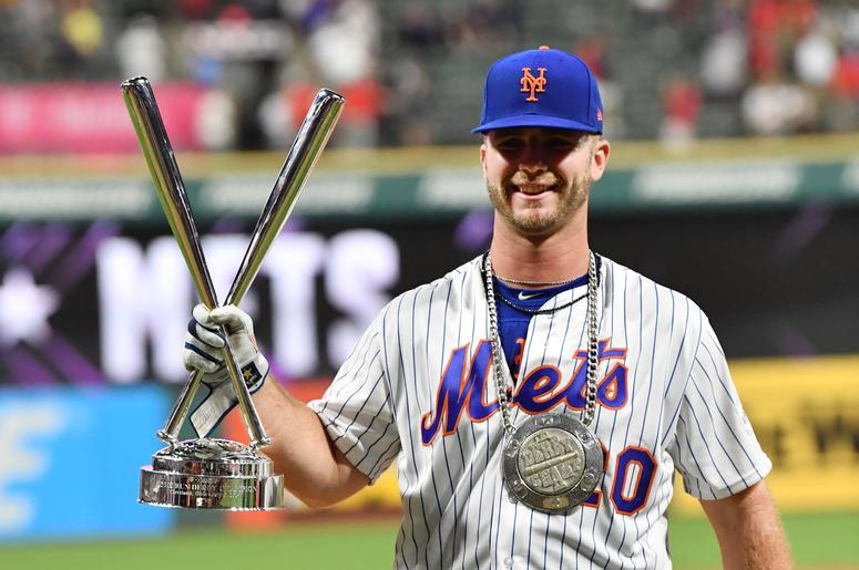 New York Mets first baseman Pete Alonso (20) hold the trophy after winning in the 2019 MLB Home Run Derby at Progressive Field.