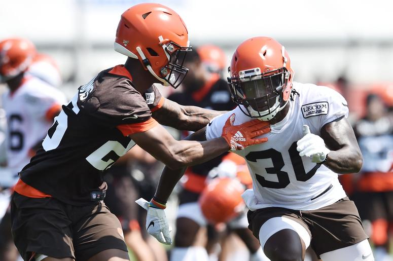 Cleveland Browns running back D'Ernest Johnson (30) runs a route against cornerback Greedy Williams (26) during training camp at the Cleveland Browns Training Complex