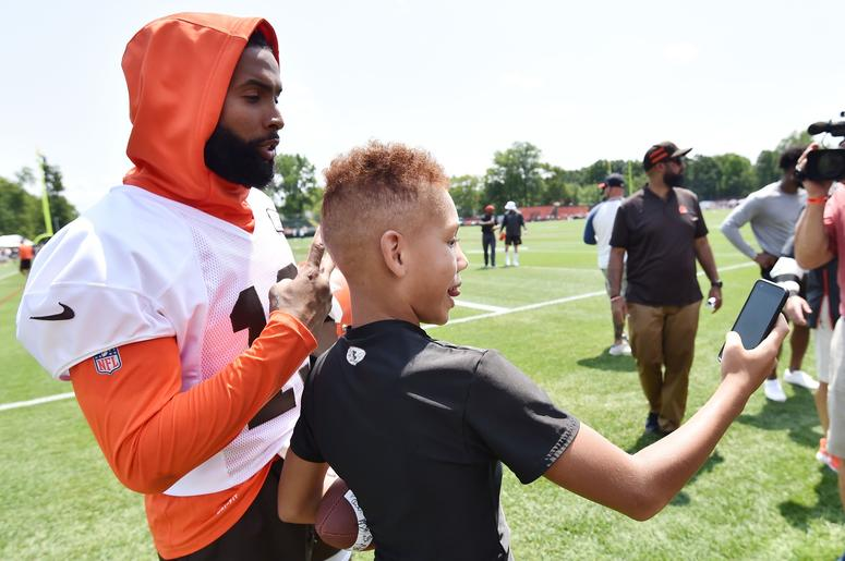 Cleveland Browns wide receiver Odell Beckham (13) poses for a photo with a fan after training camp at the Cleveland Browns Training Complex.