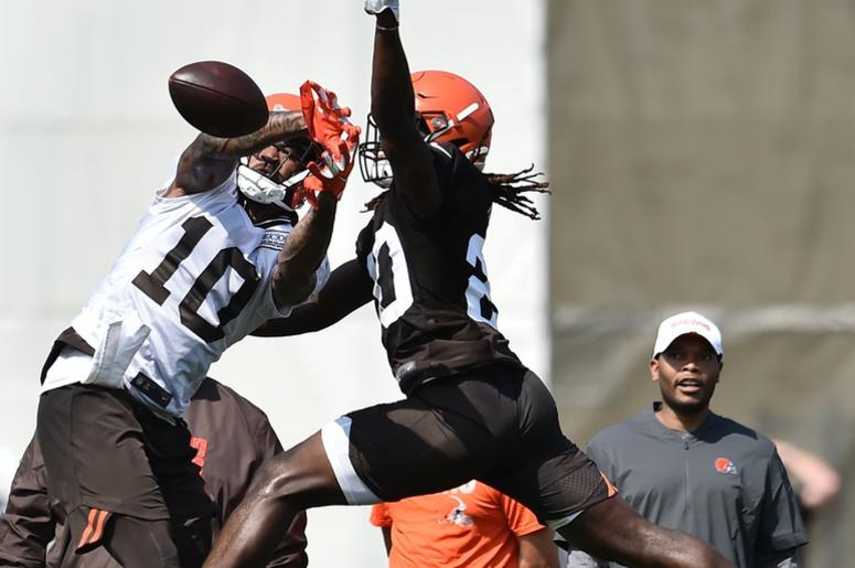 Cleveland Browns wide receiver Jaelen Strong (10) and cornerback Tavierre Thomas (20) go for a pass during training camp at the Cleveland Browns Training Complex.