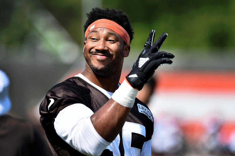Cleveland Browns defensive end Myles Garrett (95) waves the crowd during training camp at the Cleveland Browns Training Complex.