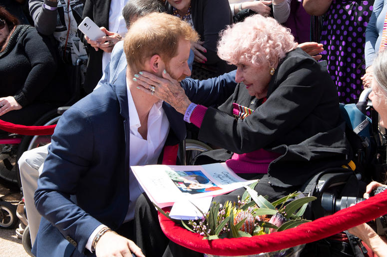 The Duke of Sussex meets 97 year old Dafney Dunne during a walkabout outside the Sydney Opera House on the first day of the Royal couple's visit to Australia.