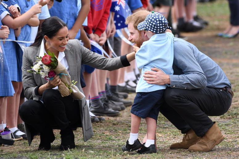 Prince Harry Duke of Sussex and Meghan Duchess of Sussex arrive at Dubbo Airport where they meet Luke Vincent, 5, from Buninyong Public School Kindergarten, New South Wales, Australia
