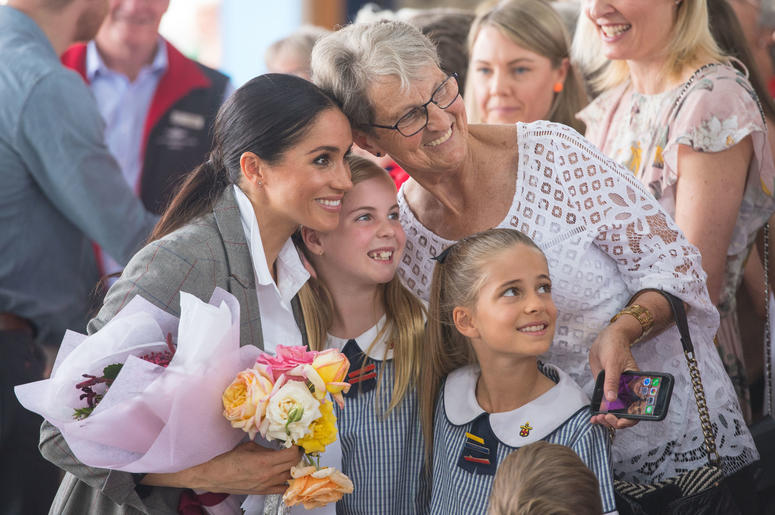 he Duchess of Sussex poses for a photo with members of the public at the naming and unveiling of a new Royal Flying Doctor Service aircraft at Dubbo City Regional Airport, in Dubbo, New South Wales, on the second day of the royal couple's visit to Austral