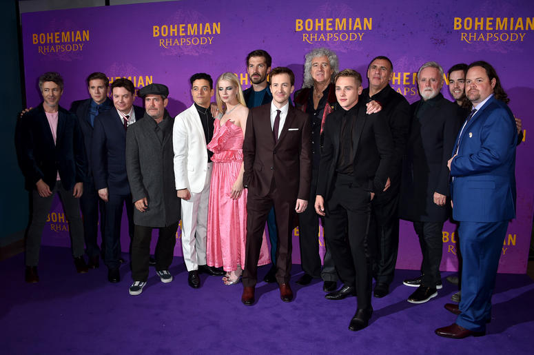 Left to right, Aidan Gillen, Allen Leech, Mike Myers, Tom Hollander, Rami Malek, Lucy Boynton, Gwilym Lee, Joseph Mazzello, Brian May, Ben Hardy, Graham King, Roger Taylor and guests attending the Bohemian Rhapsody World Premiere held at the the SSE Arena