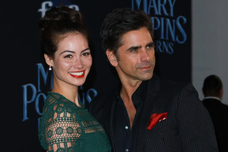 Caitlin McHugh (L) and John Stamos at the Disney's 'Mary Poppins Returns' Los Angeles Premiere held at the Dolby Theatre on November 29, 2018 in Hollywood, CA, USA