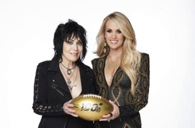 Joan Jett, left, and Carrie Underwood pose with a 100th anniversary NFL football.