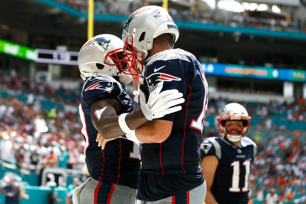 Tom Brady present at Patriots practice, talking to Antonio Brown