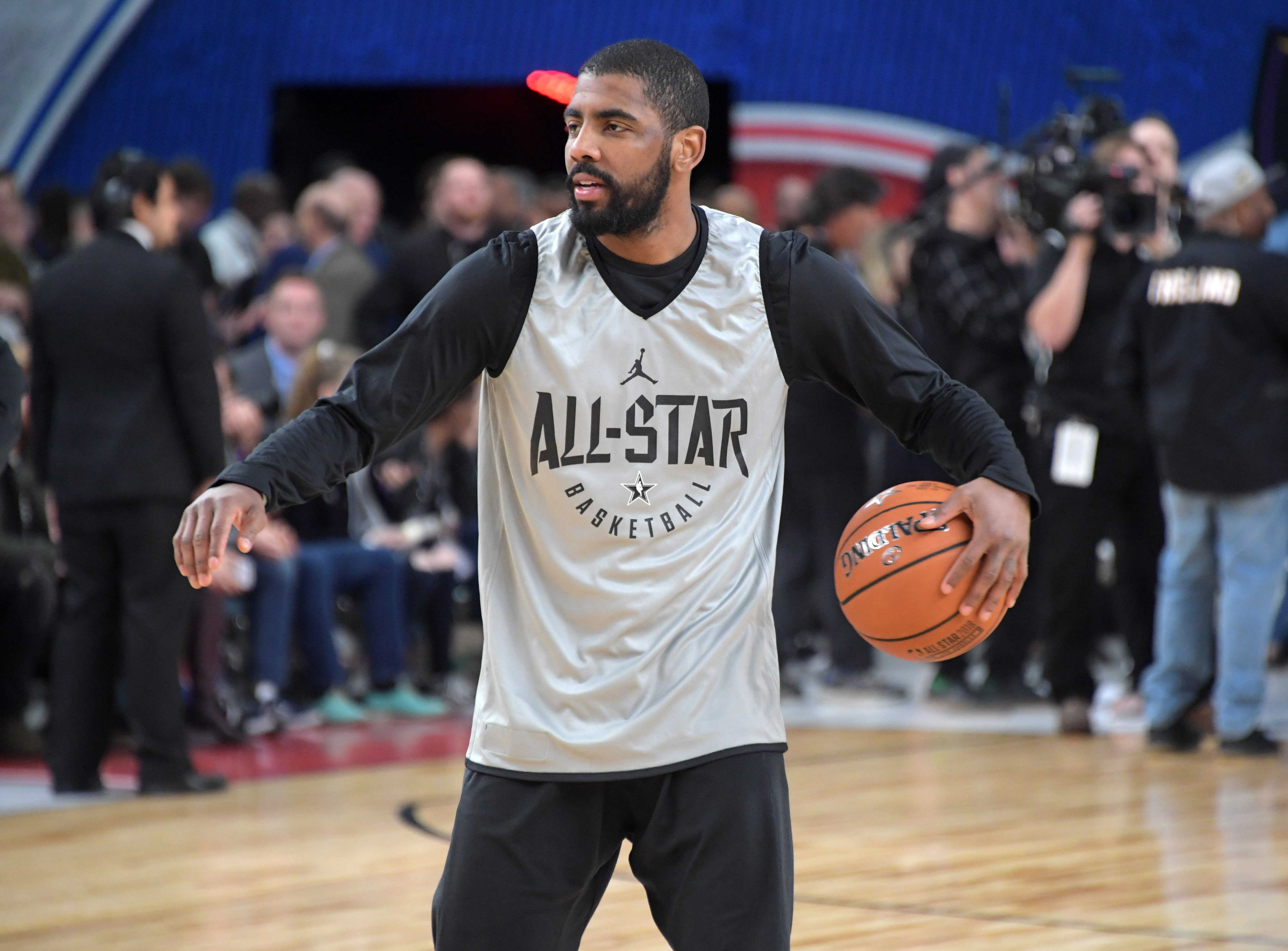 1c7e9b9c409d Fan wears Kyrie Irving  Flat Earth  jersey to NBA All-Star Game
