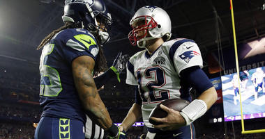 Richard Sherman shakes hands with Tom Brady after Super Bowl XLIX.