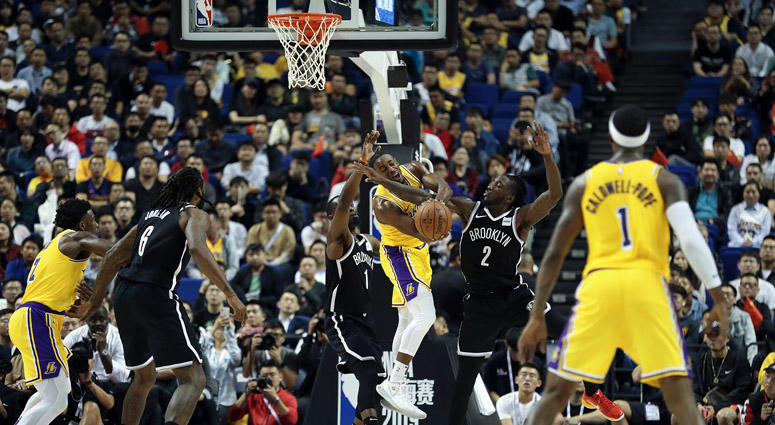 The Lakers' Demetrius Jackson in action against the Nets' Taurean Prince during a preseason game as part of 2019 NBA Global Games China at Mercedes-Benz Arena on Oct. 10, 2019 in Shanghai, China.