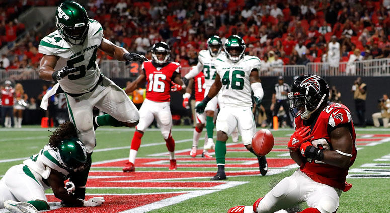 Brian Hill of the Atlanta Falcons fails to pull in this reception for a TD against Tevaughn Campbell and Avery Williamsonof the Jets on Aug. 15, 2019 in Atlanta.