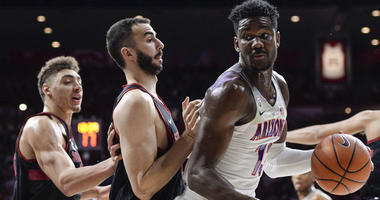 Arizona's Deandre Ayton is defended by a pair of Stanford players on March 1, 2018, at the McKale Center in Tucson, Arizona.