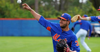 Anthony Swarzak warms up at practice on Feb. 14, 2018, in Port St. Lucie, Florida.