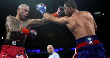 Miguel Cotto (red trunks) and Sadam Ali during the WBO junior middle weight world championship boxing fight at Madison Square Garden