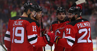 The Devils celebrate a goal by Taylor Hall (9) against the Pittsburgh Penguins on March 29, 2018, at the Prudential Center.