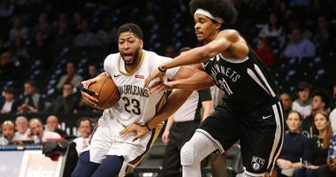 The Nets' Jarrett Allen defends the New Orleans Pelicans' Anthony Davis