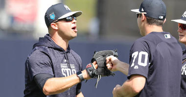 Yankees guest instructor Nick Swisher talks with center fielder Jake Cave during spring training on Feb. 20, 2008, at George M. Steinbrenner Field in Tampa, Florida.