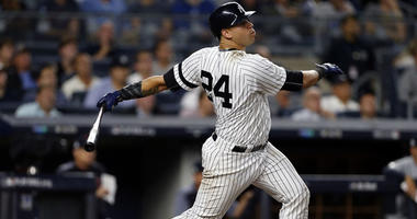 Gary Sanchez hits a solo home run in Game 4 of the Yankees' AL divisional series game against the Cleveland Indians on Oct. 9, 2017, at Yankee Stadium.