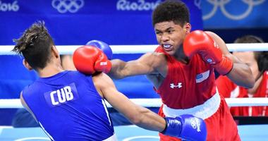 Robeisy Ramirez of Cuba, blue, and Shakur Stevenson of the USA compete in a men's bantamweight boxing event during the Rio 2016 Summer Olympic Games.