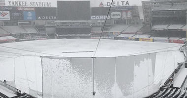 Snow is seen on the field of Yankee Stadium on April 2, 2018.