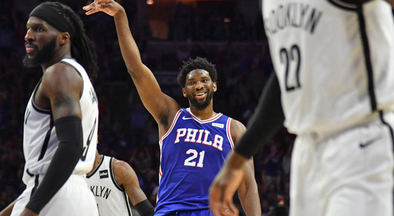 76ers center Joel Embiid (21) reacts after making a three-point shot against the Brooklyn Nets during the second quarter in game five of the first round of the 2019 NBA Playoffs at Wells Fargo Center.