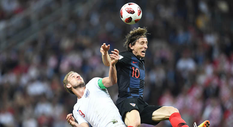 Croatia midfielder Luka Modric (10) plays for the ball against England forward Harry Kane in the semifinals of the FIFA World Cup 2018 on July 11, 2018, at Saint Petersburg Stadium in Moscow.