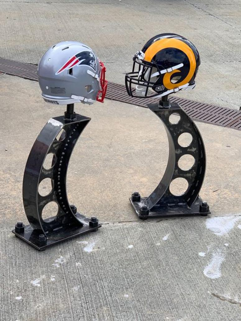 Helmets of the New England Patriots and Los Angeles Rams inside Mercedes-Benz Stadium. (Credit: Adam W. Bloom)