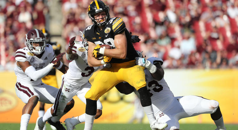Iowa Hawkeyes tight end T.J. Hockenson (38) runs with the ball as Mississippi State Bulldogs cornerback Cameron Dantzler (3) defends during the second half in the 2019 Outback Bowl at Raymond James Stadium. Mandatory Credit: Kim Klement-USA TODAY Sports