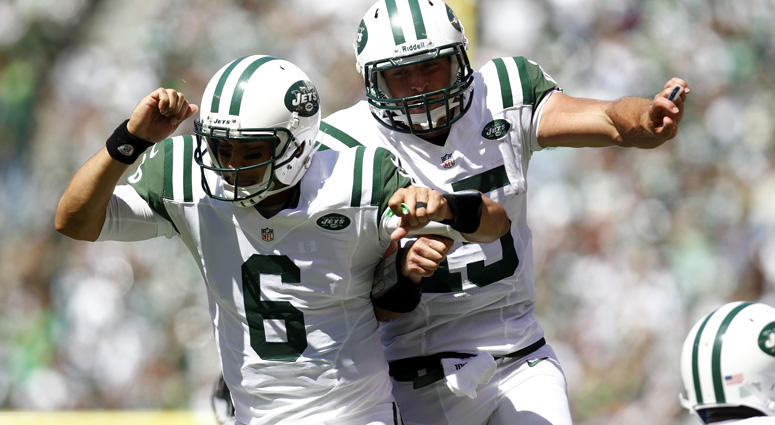 The Jets' Mark Sanchez (6) and Tim Tebow celebrate a touchdown against the Buffalo Bills during their season opener at MetLife Stadium on Sept. 9, 2012.